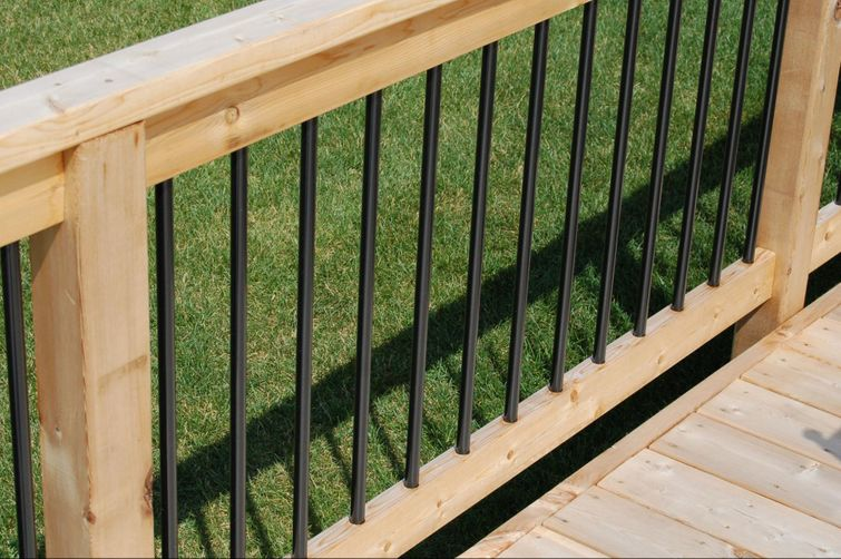 Natural wood boards and railing on a new deck.