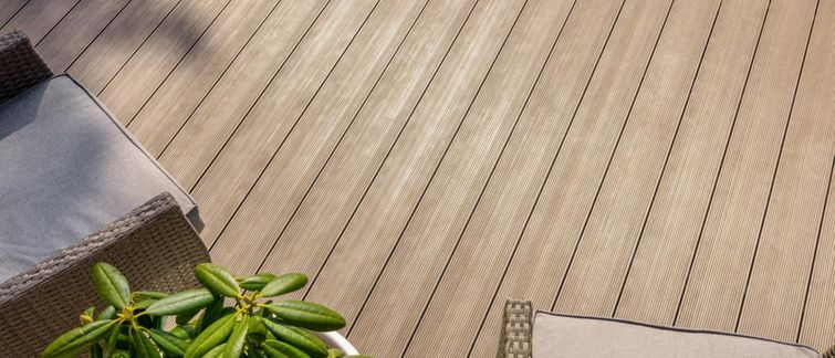 Installed sand-coloured PVC deck boards.