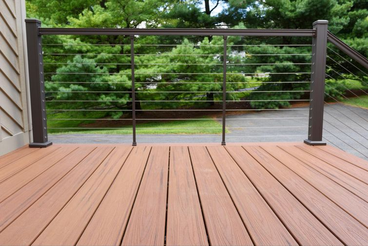 Composite deck made of boards that resemble wood.