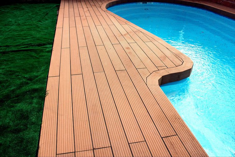Composite has increased traction and absorbs less water, making it the best for around pools.