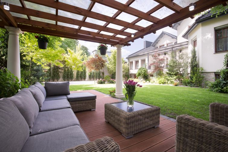 Adding a pergola can keep direct sunlight from your composite.