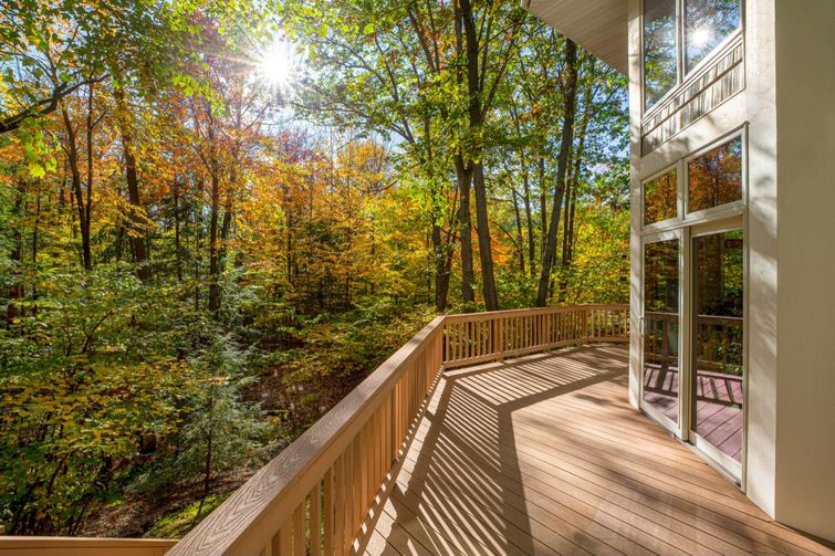 Wrap-around composite deck on a beautiful fall day.