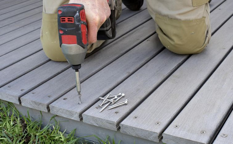 Assembling a composite deck with wood texture.