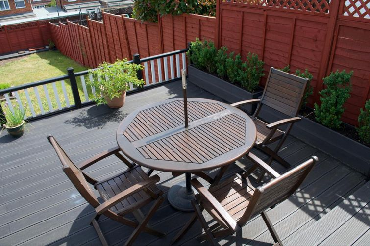Dark colours like this composite deck will retain more heat than light ones.