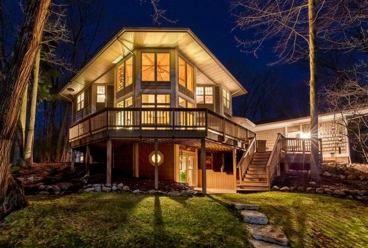 Beautiful home with large wrap-around composite deck.